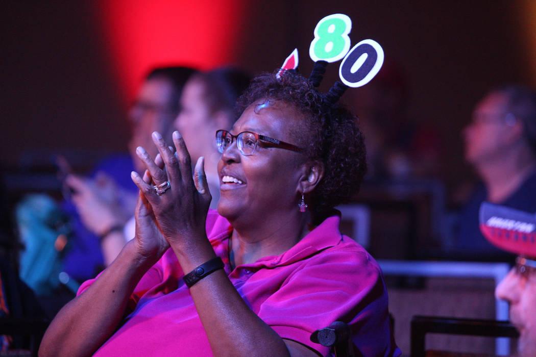 Debbie Hughes, of Las Vegas, cheers during the 2019 Dafabet US Darts Masters at Mandalay Bay on ...