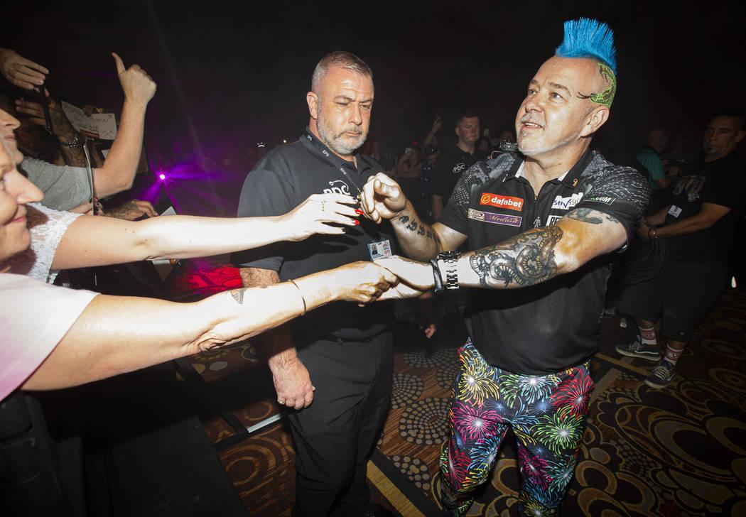 Peter Wright greets fans during the 2019 Dafabet US Darts Masters at Mandalay Bay on July 4, 20 ...