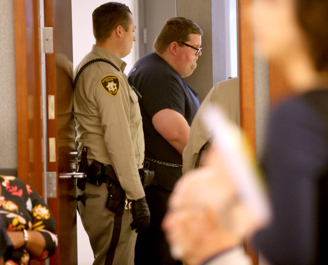 Security guard Brian William Love prepares to appear in court at the Regional Justice Center in ...