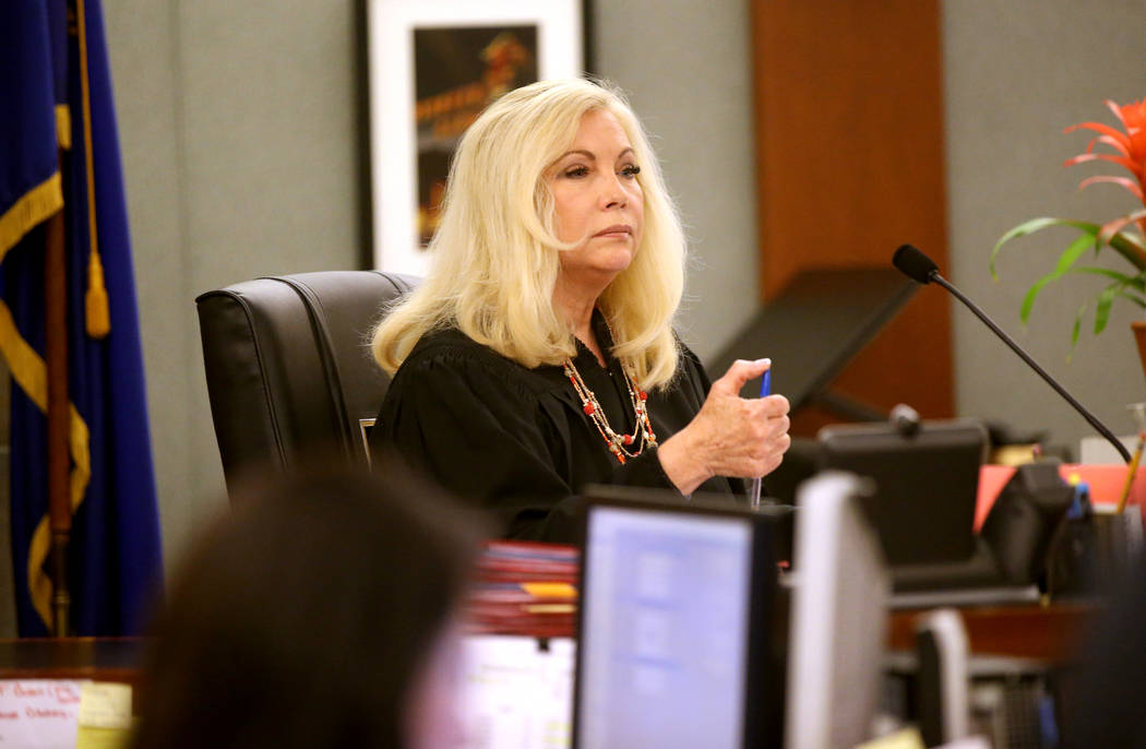Justice of the Peace Pro Tem Nancy Oesterle presides as security guard Brian William Love appea ...