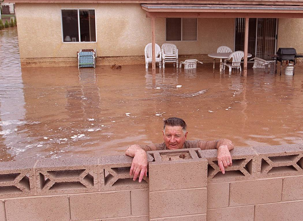 A man stands in the backyard of his flooded home during the 1999 flood. (Las Vegas Review-Journal)