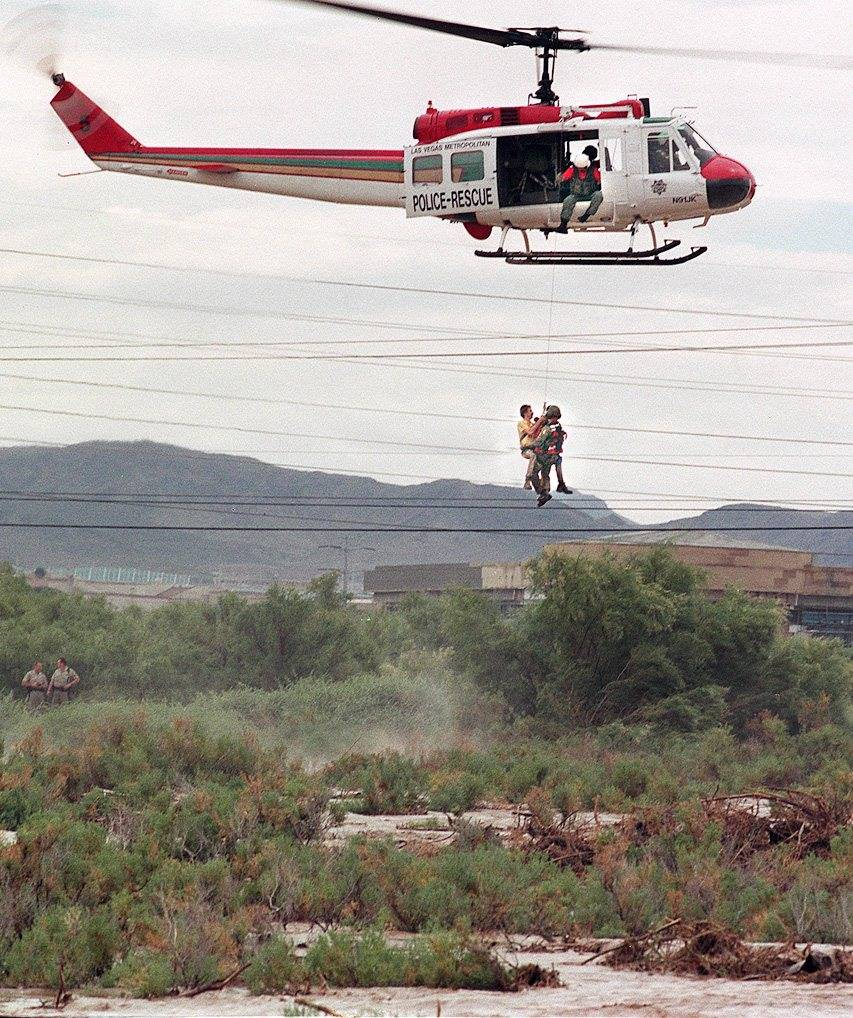 Las Vegas police rescue a man to safety after his vehicle was washed off Boulder Highway into F ...