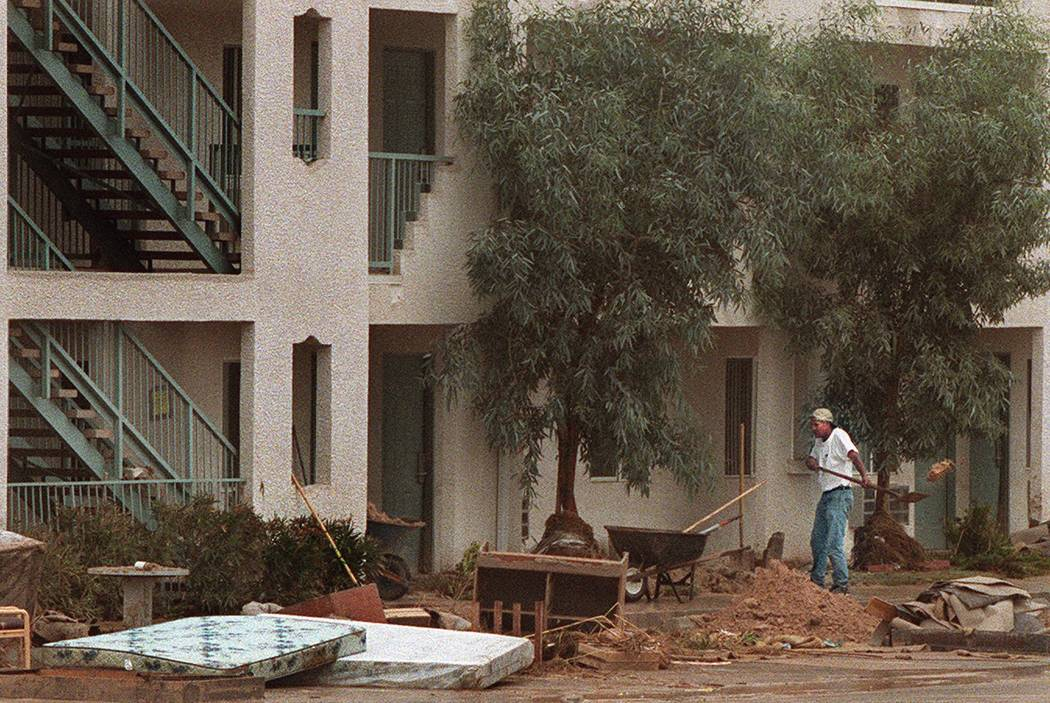 A worker cleans up flood debris at The Ramada Limited Hotel on Boulder Highway. (Las Vegas Revi ...