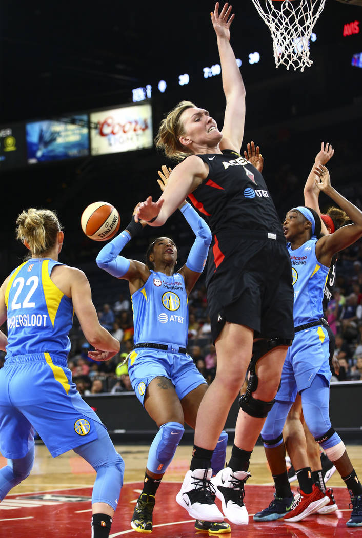 Las Vegas Aces' Carolyn Swords, center right, goes for a rebound against Chicago Sky defenders ...