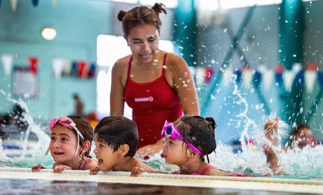 Lorelai Zimring, 5, from left, Stefan Flores, 4, and Ariana Villeda, 4, practice together as th ...