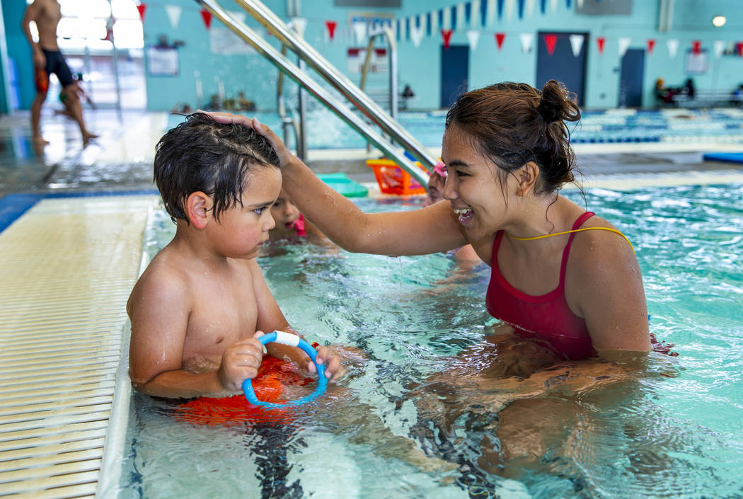 Swim instructor Shanneal Ocular talks with her student Louis Borado, 3, during a beginner swim ...