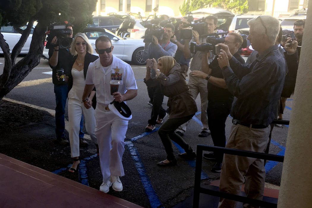 Navy Special Operations Chief Edward Gallagher, center right, walks with his wife, Andrea Galla ...