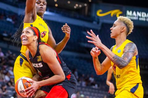 Las Vegas Aces forward A'ja Wilson (22) looks to the basket inside of Indiana Fever center Teai ...