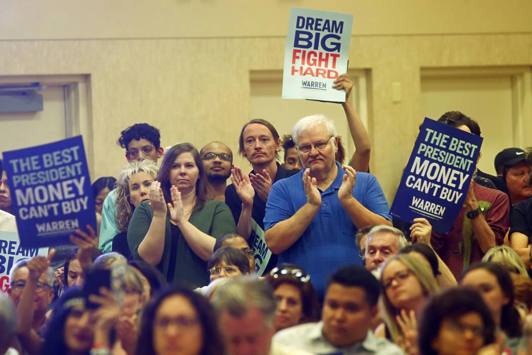 Supporters cheer as Democratic presidential candidate Sen. Elizabeth Warren, D-Mass., not pictu ...