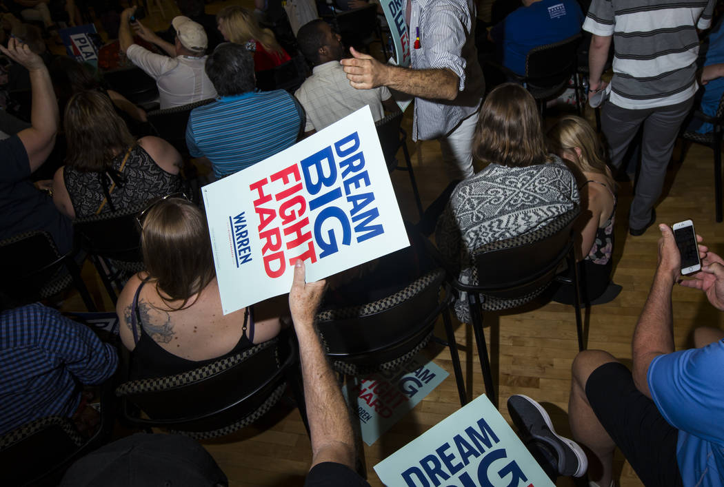 Signs are passe out in support of Democratic presidential candidate Sen. Elizabeth Warren, D-Ma ...