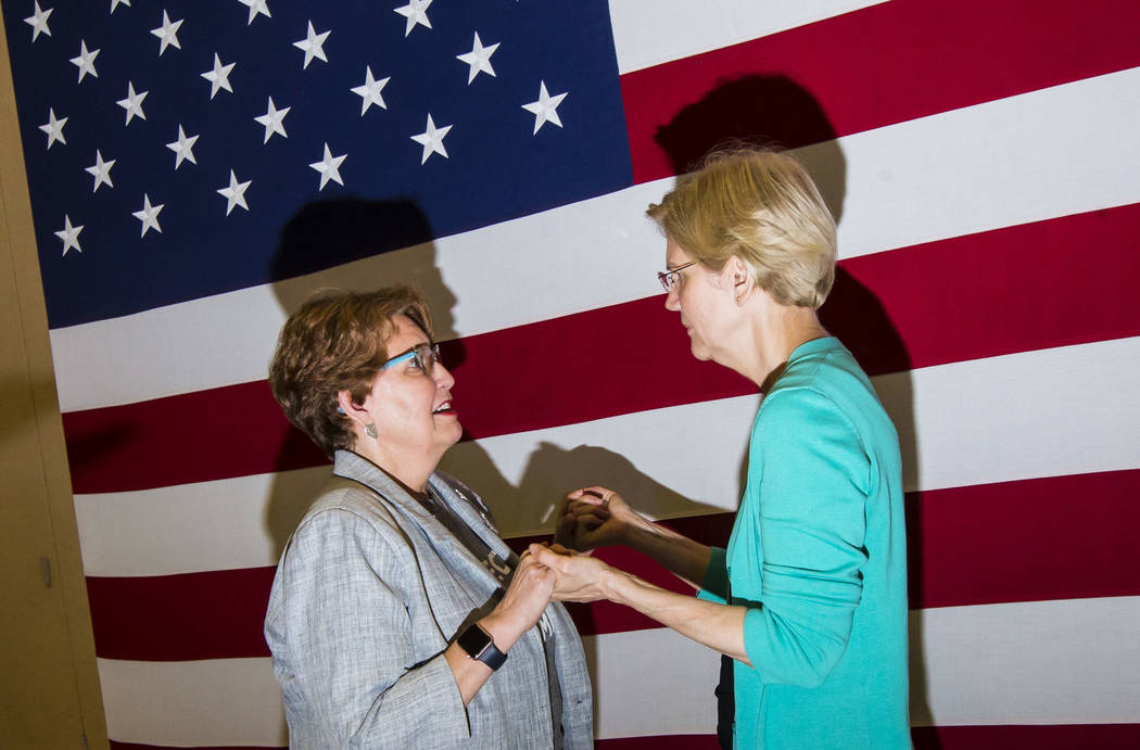 Donna West, chair of the Clark County Democratic Party, left, talks with Democratic presidentia ...