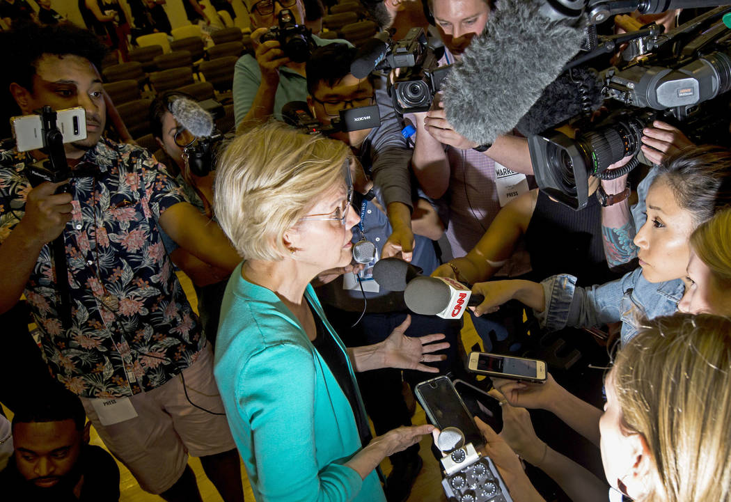 Democratic presidential candidate Sen. Elizabeth Warren, D-Mass., speaks to reporters during a ...