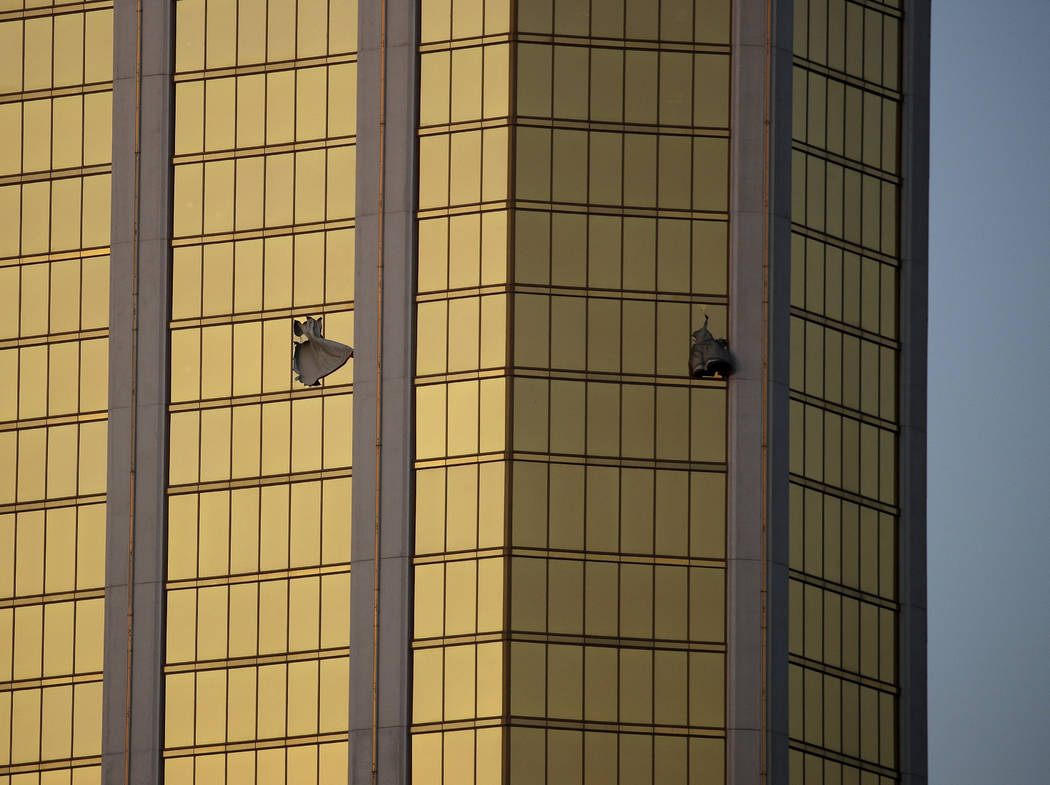 In this Oct. 2, 2017 file photo, drapes billow out of broken windows at the Mandalay Bay resort ...