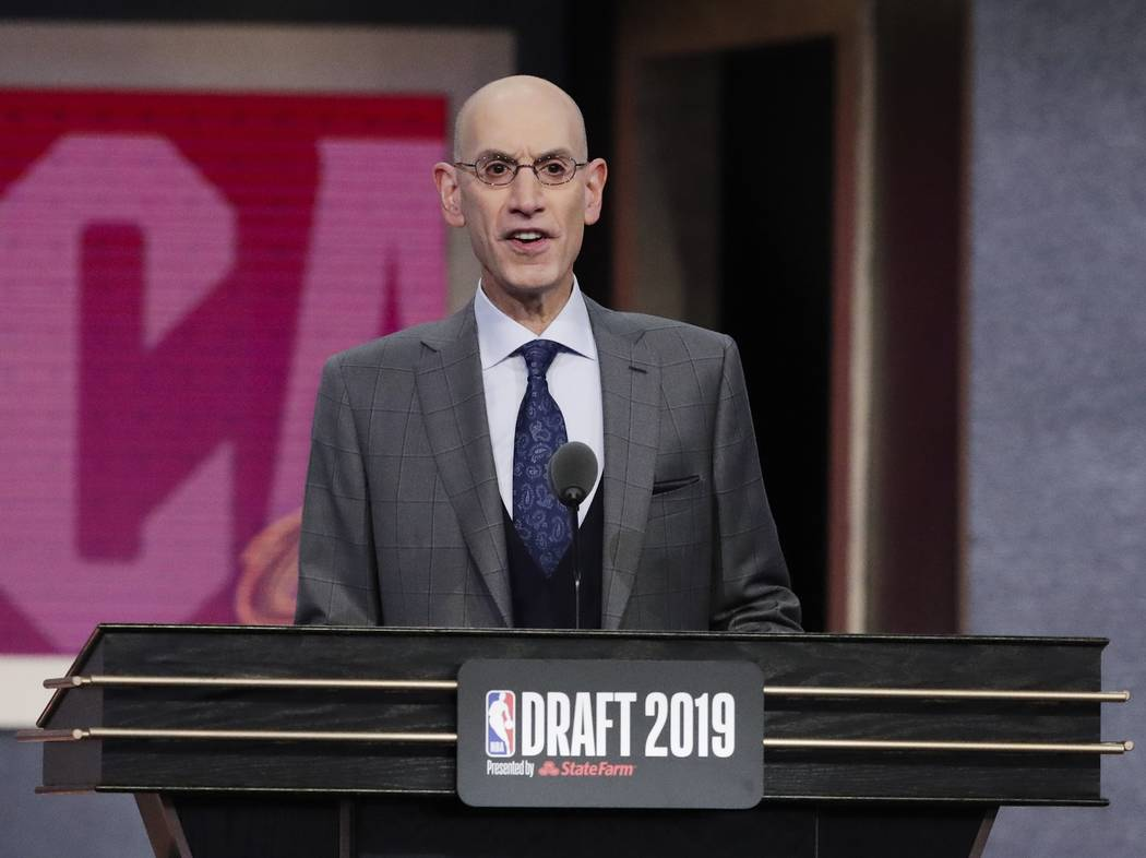 NBA Commissioner Adam Silver announces Vanderbilt's Darius Garland as the fifth pick overall by ...