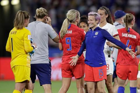 United States' Megan Rapinoe prepares to hug United States goalkeeper Alyssa Naeher after the W ...