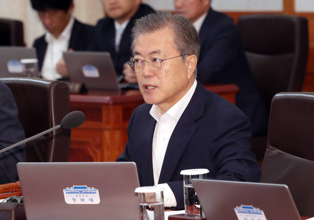 South Korean President Moon Jae-in speaks during a cabinet meeting at the presidential Blue Hou ...