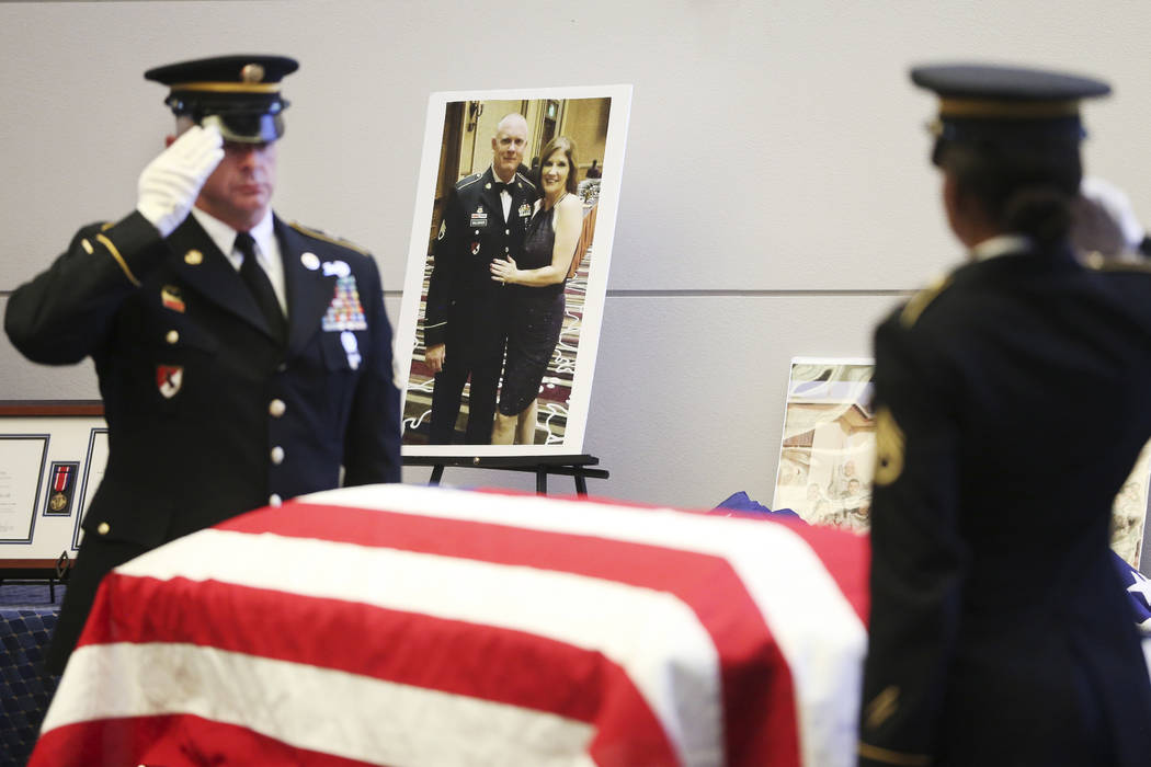 Nevada Army National Guard Sgt. 1st Class Patrick Johnson, left, and Staff Sgt. Brittney Lynch ...
