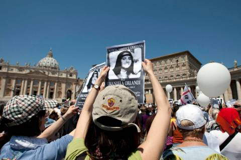 """Demonstrators hold pictures of Emanuela Orlandi reading, """"march for truth and justice for Emanu ..."""