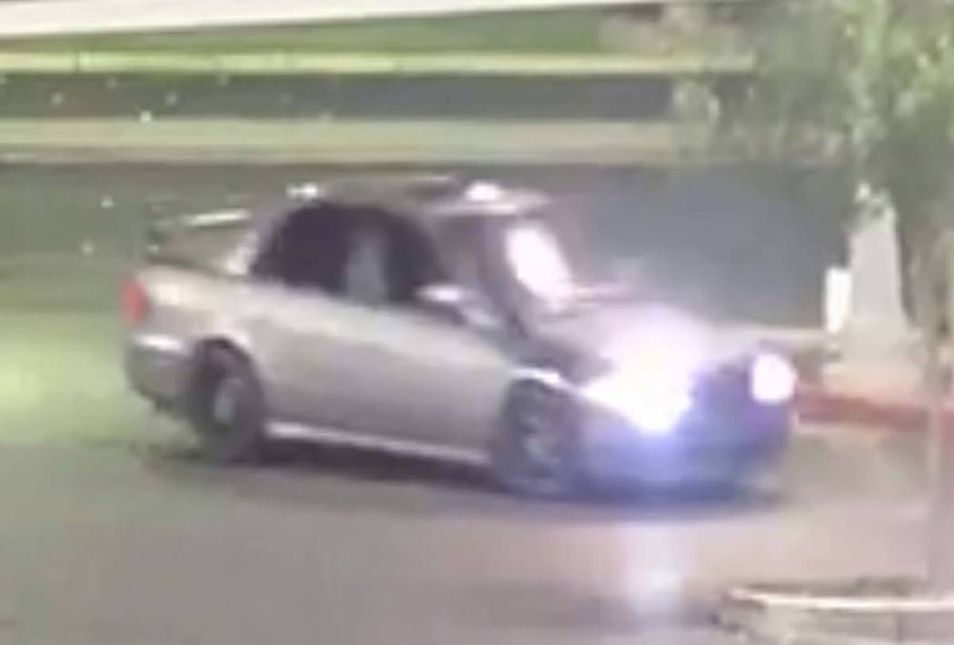 A silver, 4-door sedan with black rims, sunroof and rear spoiler used in several armed robberie ...