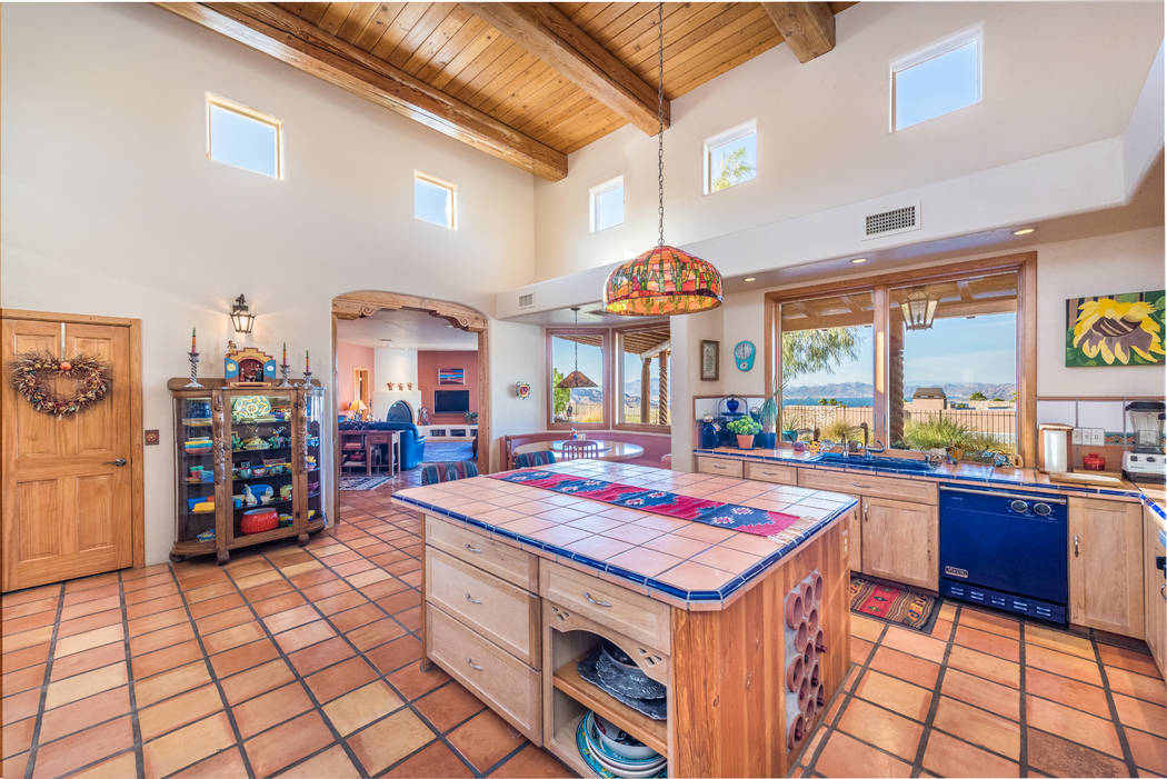 The colorful Southwestern kitchen features Saltillo tile flooring. (Desert Sun Realty)