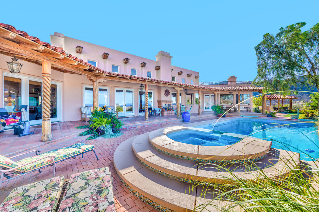 The backyard features a pool and spa. (Desert Sun Realty)