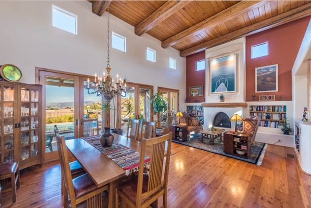 The dining and living room feature wood accents. (Desert Sun Realty)