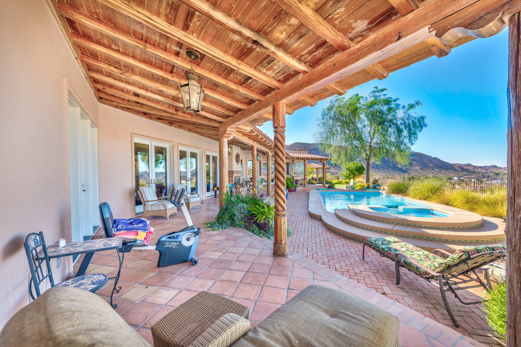 The home has a backyard patio and pool area. (Desert Sun Realty)