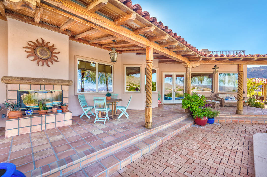 The patio has a fireplace and plenty of sitting areas. (Desert Sun Realty)