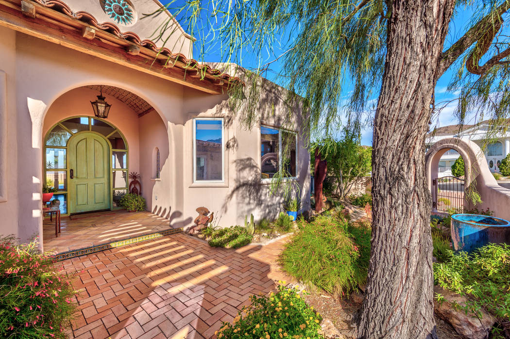The entrance of the home features lush landscaping. (Desert Sun Realty)