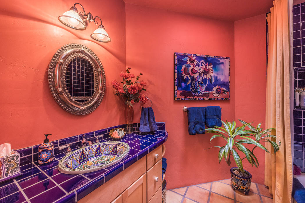 The home's guest bathroom has a splash of color. (Desert Sun Realty)