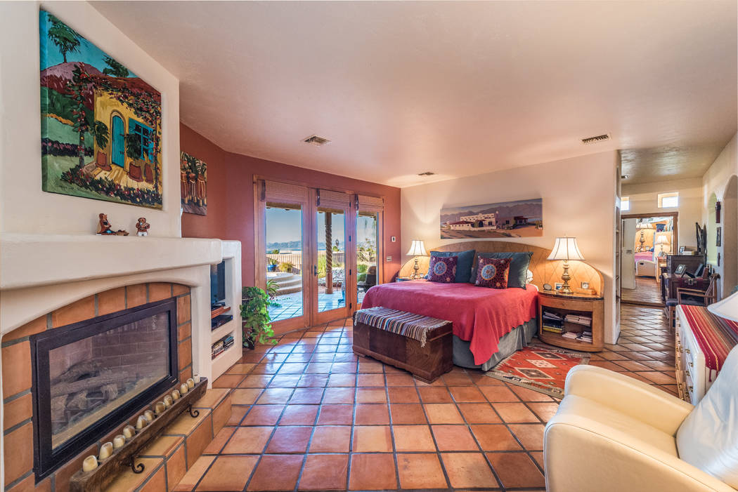 The master suite has a fireplace and access to the spa and pool. (Desert Sun Realty)