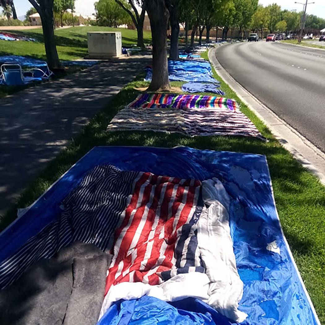 Blankets, plastic tarps, canopies, rocks and other items are used by residents to mark their vi ...