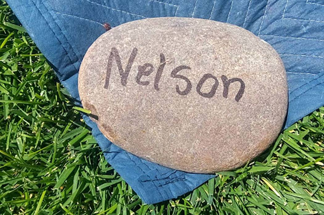 """A """"Nelson"""" rock holds down a corner of a blanket for their place to view Thursday's Summerlin C ..."""