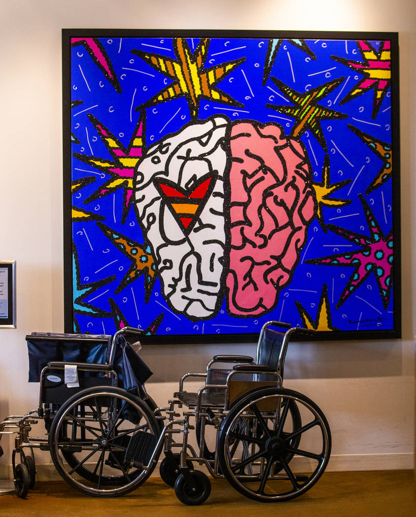 Wheelchairs are parked beside brain-related art at the Cleveland Clinic Lou Ruvo Center for Bra ...
