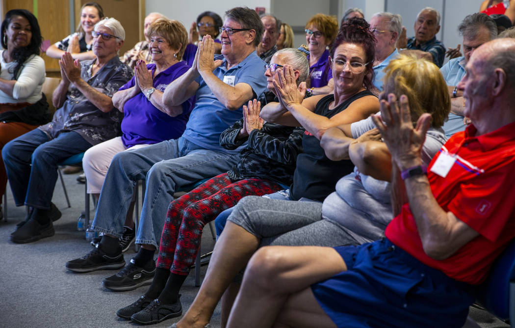 Participants do some group exercises amongst songs, stories and more during a Memory Cafe - Res ...