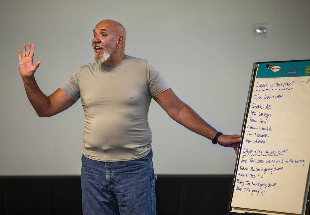 Volunteer Jay Nagle leads a group story amongst songs, exercises and more during a Memory Cafe ...