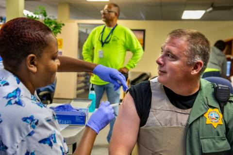 Tasheka Powell, Southern Nevada Health District registered nurse, gives Metropolitan Police Dep ...