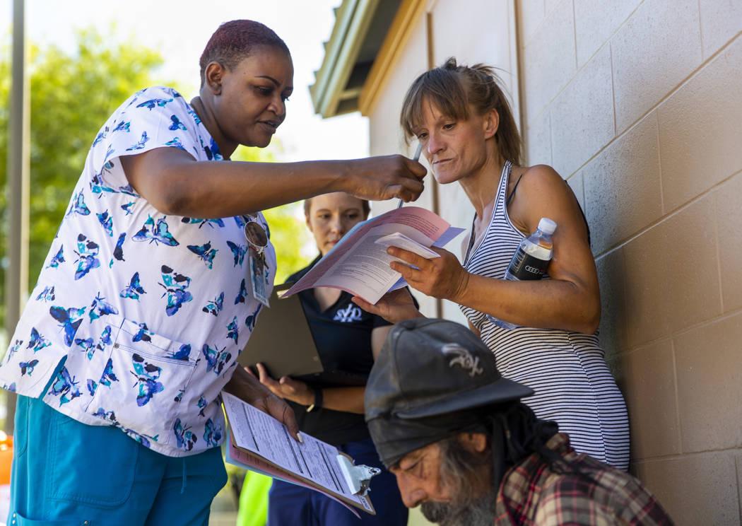 Tasheka Powell, Southern Nevada Health District registered nurse, left, and Sarah Lugo, Souther ...