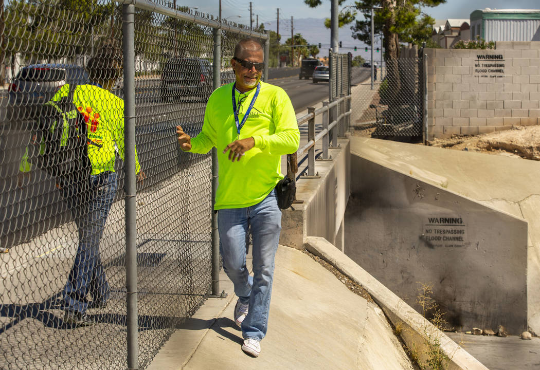 Louis Lacey, director of Crisis Teams at HELP of Southern Nevada, looks down on a drainage ditc ...