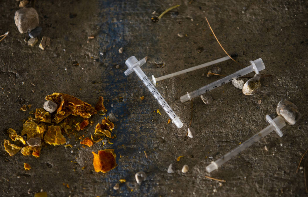 Spent needles litter the ground in a drainage ditch off of W. Tropicana Avenue. near S. Rainbow ...