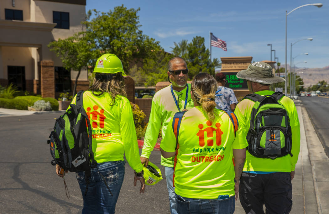 HELP of Southern Nevada Director of Crisis Teams Louis Lacey, center, coordinates the next move ...