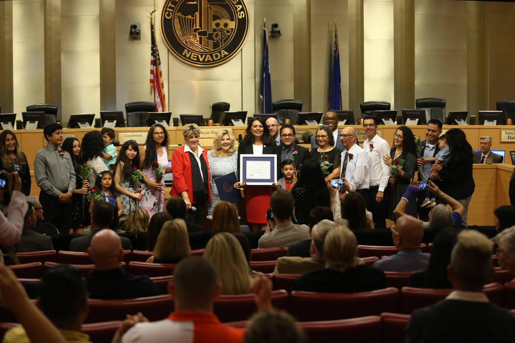 New Councilwoman Olivia Diaz, center, is photographed with her family and city dignitatries aft ...