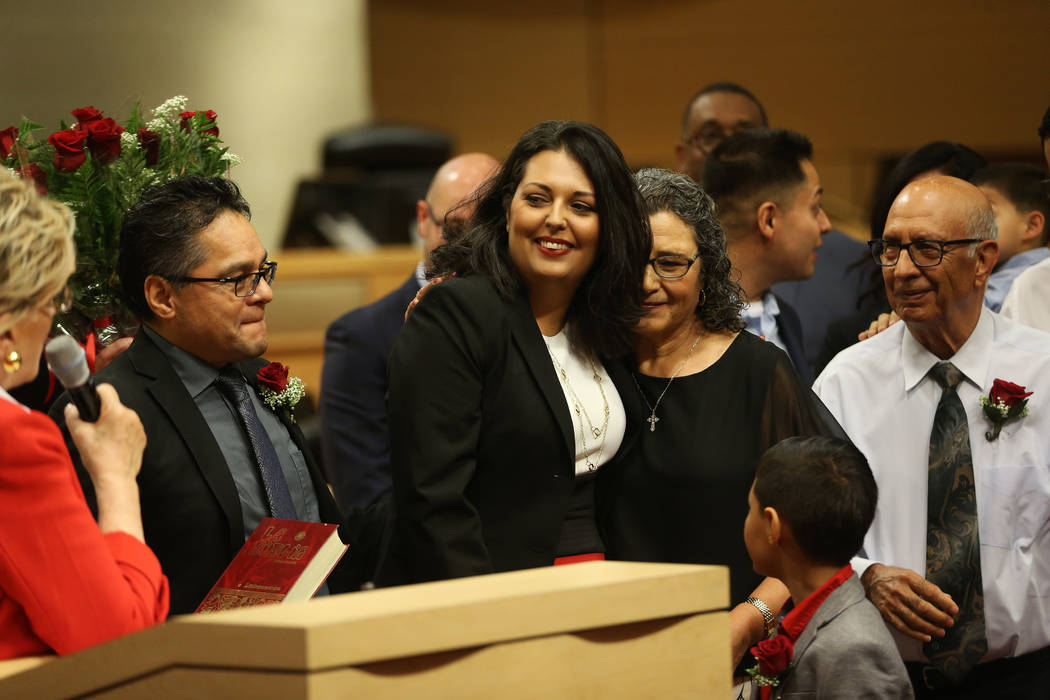 New Councilwoman Olivia Diaz, center, with her husband Frank, left, and her parents Alejandra O ...