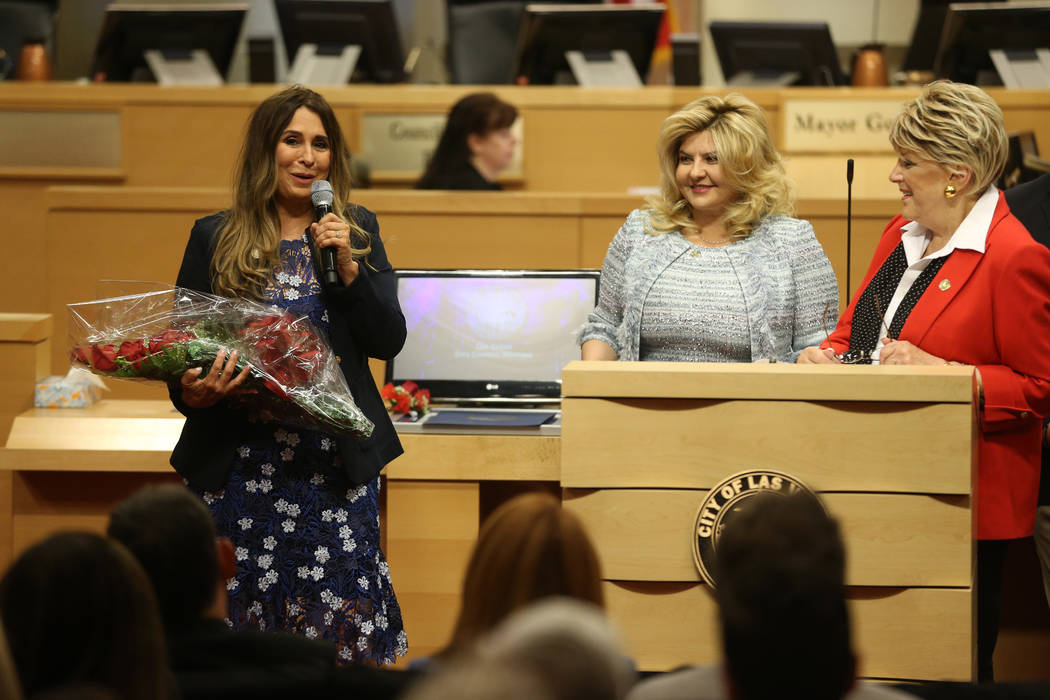 New Councilwoman Victoria Seaman, from left, gives a speech after getting sworn into office, wi ...