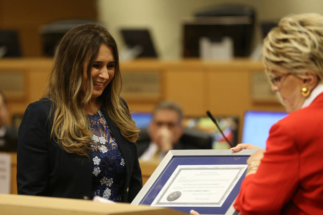 New Councilwoman Victoria Seaman receives a certificate of election from Mayor Carolyn Goodman ...