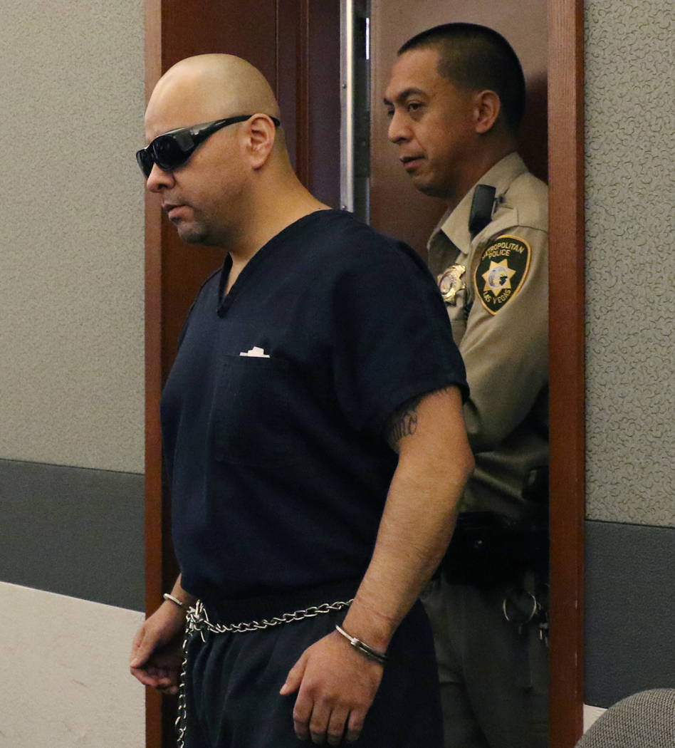 Gustavo Ramos-Martinez, who is accused of killing two elderly people in 1998, is led into the c ...