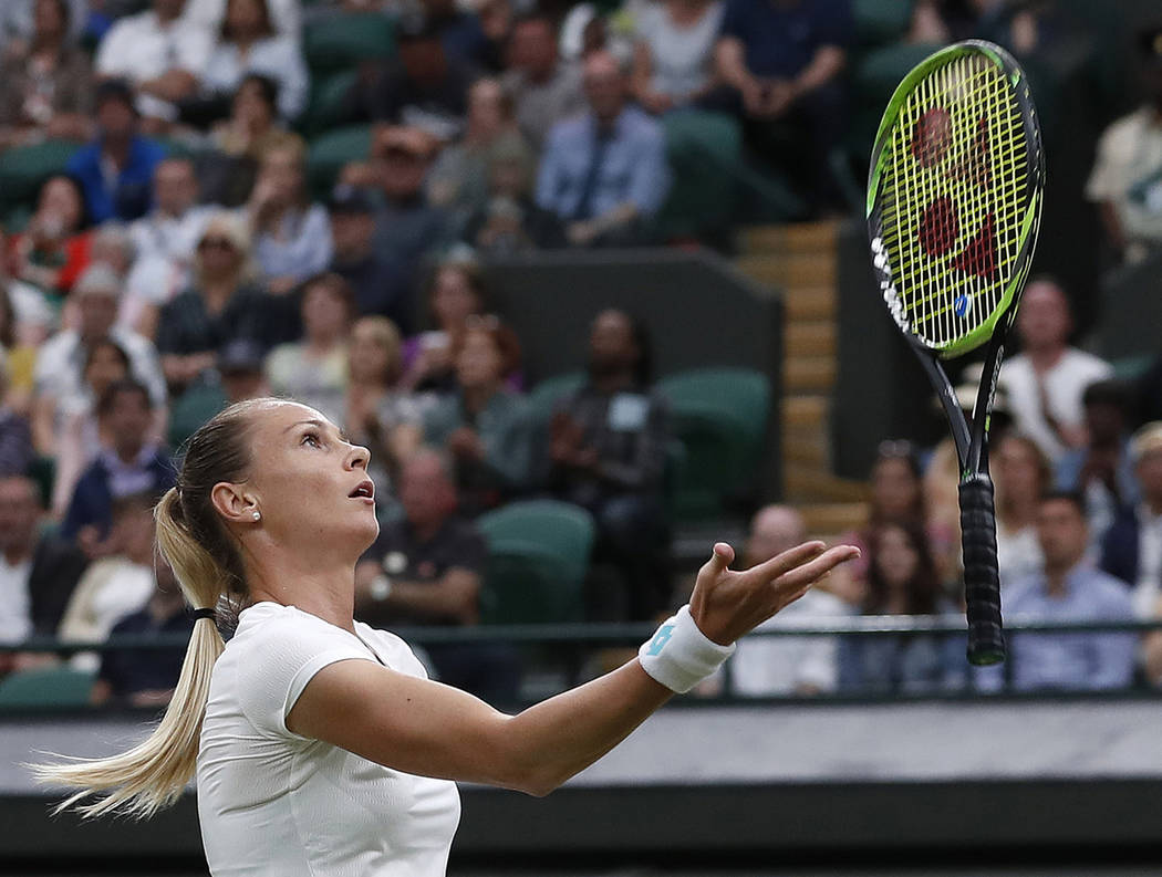 Slovakia's Magdalena Rybaikova tosses her racquet into the air after a shot to United States' C ...