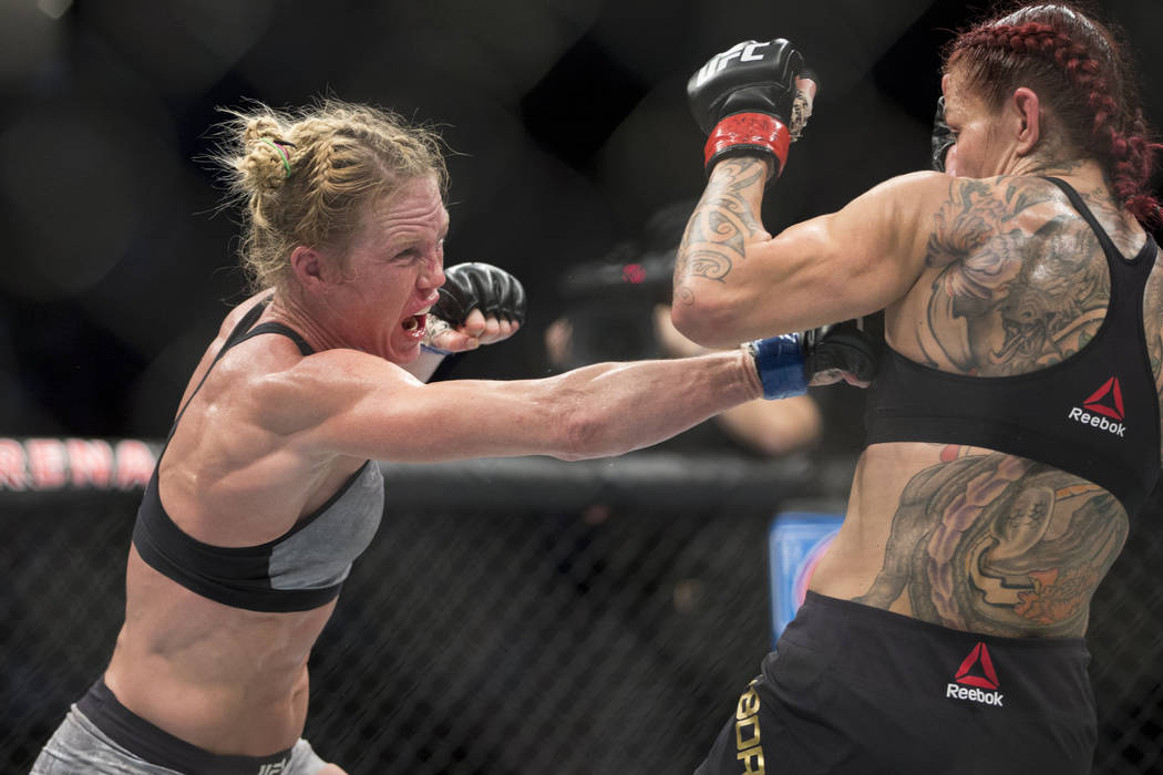 """Holly Holm, left, battles Cris """"Cyborg"""" Justino in the UFC 219 women's feather ..."""
