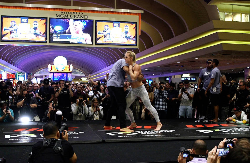 UFC bantamweight contender Holly Holm warms up at the open workouts at the MGM Grand hotel-casi ...