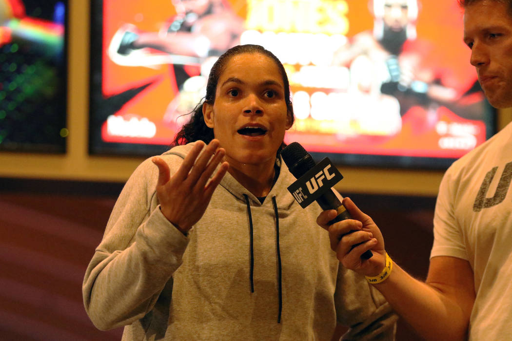 UFC women's bantamweight and featherweight champion Amanda Nunes answers questions at the open ...